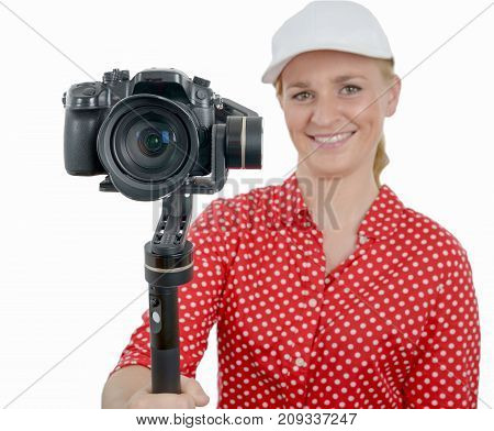 a young woman with dslr video stabilizer isolated on the white background