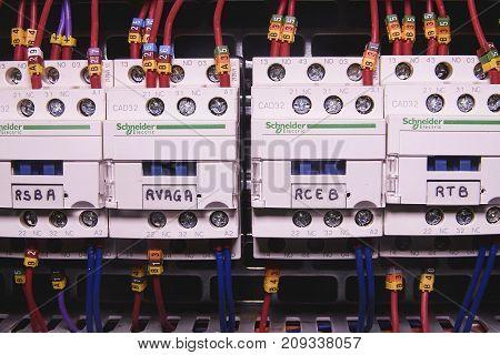 HUSTOPECE, CZECH REPUBLIC - APRIL 10, 2017: Image shows control cubicle. Schneider electric contactors inside power case.