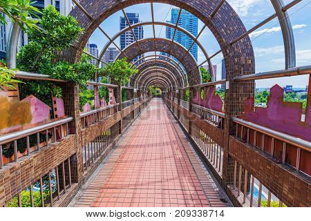 TAICHUNG TAIWAN - JULY 18: Footbridge and mordern architecture in the downtown financial district on July 18 2017 in Taichung