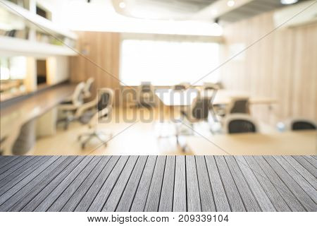 Empty top of wooden table and library room interior blur background for your design