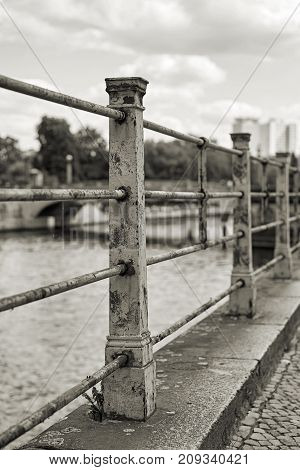 old historical railing on the banks of the river Spree in Berlin