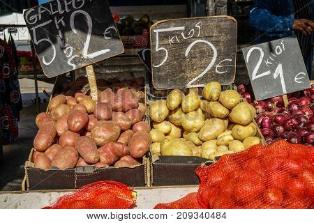 Street market in Madrid Spain. Red potatoes new potatoes and onion and a sack.