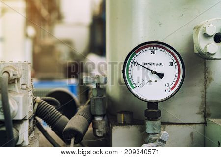 pressure gauge was mounted on the old machine measuremant and equipment in the industry