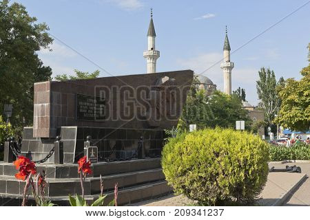 Evpatoria, Republic of Crimea, Russia - July 19, 2017: Monument to the heroes of the Yevpatoria landing and the Juma-Jami mosque in the city of Evpatoria