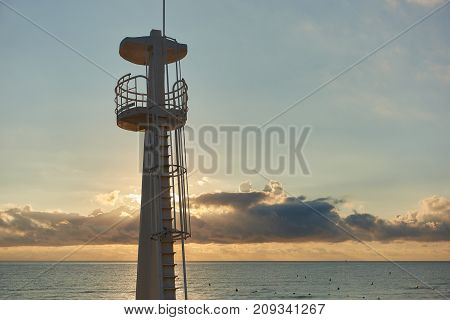 Beautiful sunrise above the Mediterranean Sea and lifeguard tower on the beach. Torrevieja. Costa Blanca. Spain