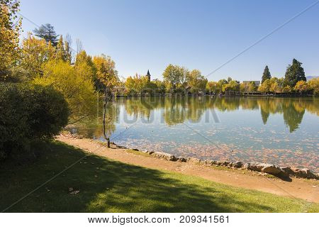 Autumn Colors And Reflection On The Puigcerda's Pond Water