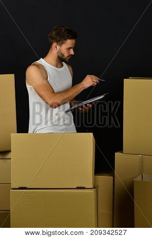 Guy With Clip Board Checking On Amount Of Cartons