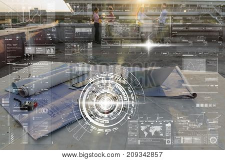 Construction equipment such as blueprint Safety glasses and technology laptop over the photo blurred of engineers working with with technology digital virtual screen background industrial concept, 3D illustration