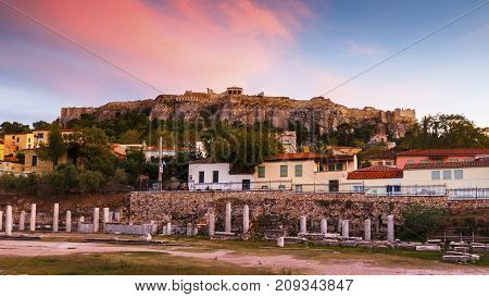 Acropolis and remains of Roman Agora in the old town of Athens, Greece.