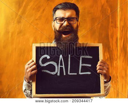 Bearded Man, Brutal Caucasian Hipster Holding Sale Inscription On Blackboard