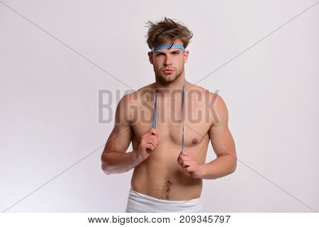 Man With Confident Face And Measuring Tape On Naked Torso