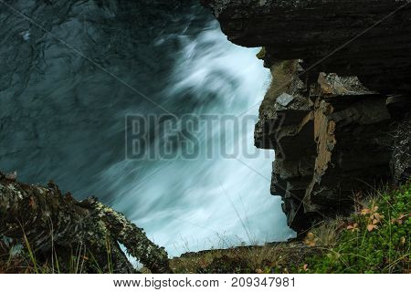 River, Jokk up north in arctic area in Scandinavia. View into the canyon, river in high speed.
