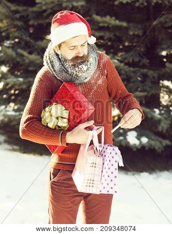 Handsome Santa Man Opens Presents