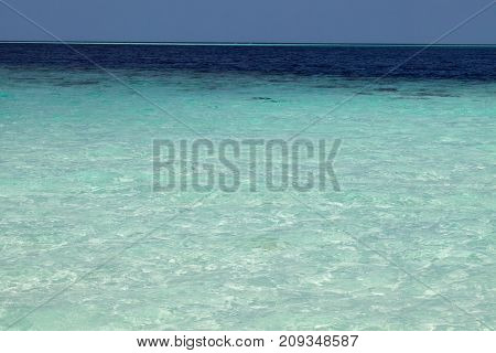 All shadows of blue in tropical sea. Natural tropical water paradise. Travel tropical island resort. Ocean nature tranquility.