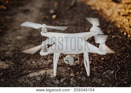 Starting white drone quad copter with camera