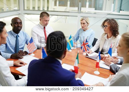 Group of representatives of several countries gathered for discussion of political chores