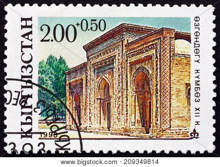 KYRGYZSTAN - CIRCA 1993: a stamp printed in the Kyrgyzstan shows Mausoleum in Uzgen Architectural Monument XII Century circa 1993