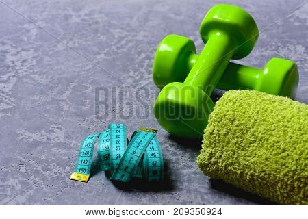 Workout And Measurement Concept. Dumbbells In Green Color
