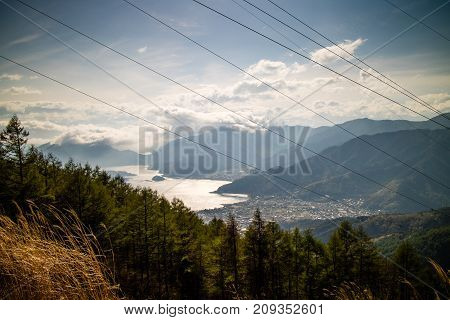 Powercables in the mountains blocking a great view of Lake Kawaguchi in Japan.