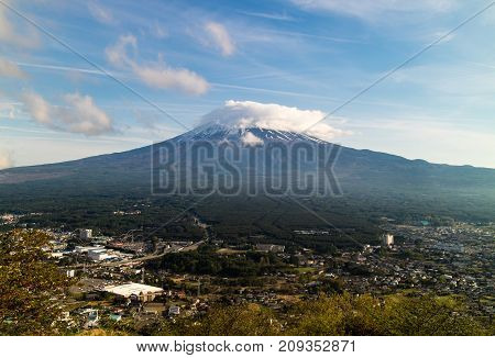 Mount Fuji being shy and hiding behind a small cloud at the start of summer.