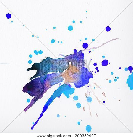 Multi colored watercolor splashes over white background