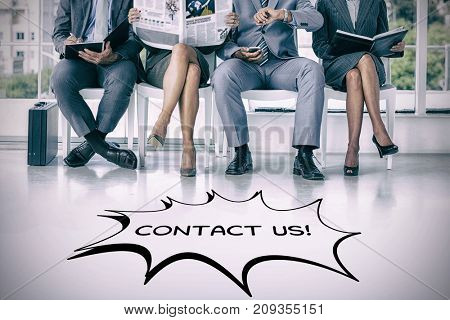 Business people waiting to be called into interview against graphic image of contact us text