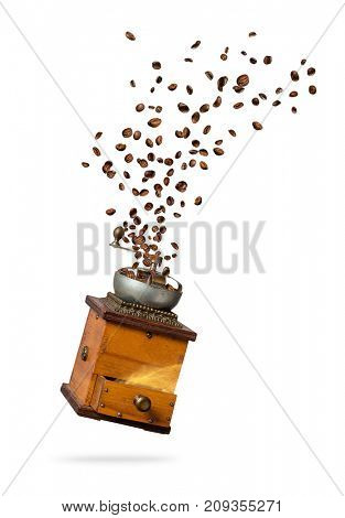 Coffee beans flying from the grinder, isolated on white background