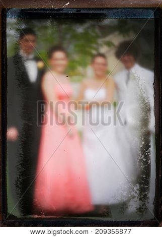 Intentionally blurred out of focus glass slide pinhole image from a high school dance
