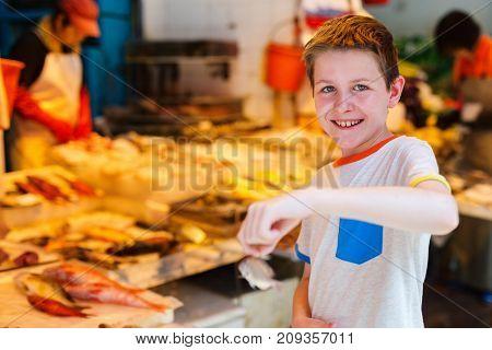 Teenage boy at wet market in Hong Kong