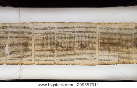 JERUSALEM, ISRAEL - OCTOBER 13 2017: One of Dead Sea Scrolls displayed in Shrine of the Book. Israel Museum Jerusalem. Israel.