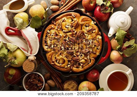 Cinnamon rolls with apples, caramel and pecan, fall baking concept overhead shot