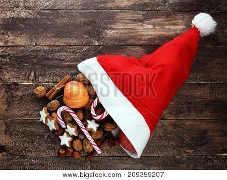 christmas cookies and santa had with spieses nuts and fruits.