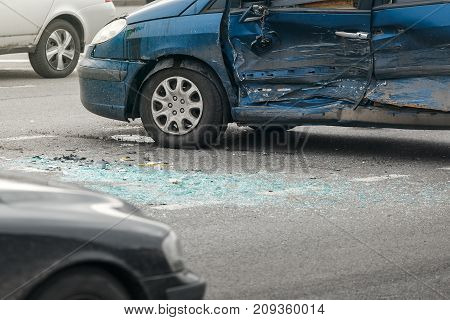 The car accident on street, damaged automobiles after collision in city, punch in the side of the machine
