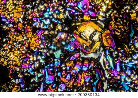 microscopic shot showing Ammonium sulfate crystals illuminated with polarized light