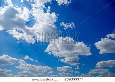 White Clouds On The Background Of The Blue Sky