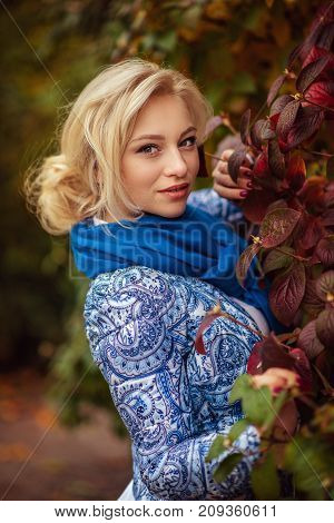beautiful girl with long white hair in an autumn park