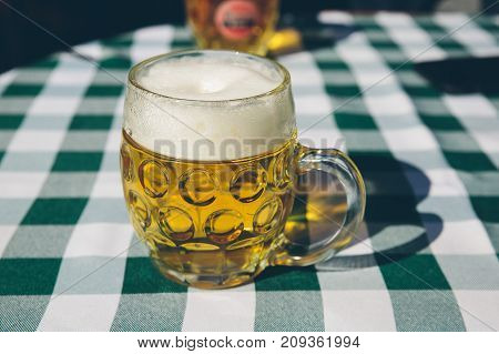Close up of a mug of beer on a table