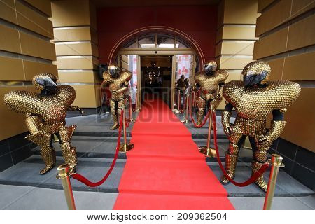MOSCOW - JUN 8, 2017: Entrance with red carpet, people robots at Award Records of real estate market 2017 in Golden Palace