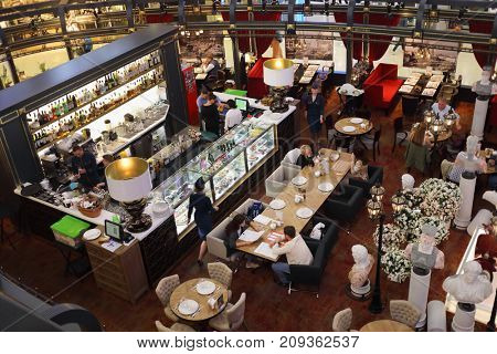 MOSCOW - SEP 11, 2017: People in cafe in European shopping center, building with area of 180,000 square meters includes more than 500 stores