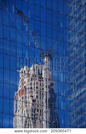 Reflection of construction of a building in glass wall
