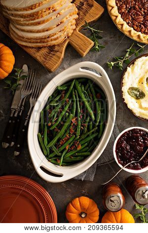 Green beans with bacon, side dish for Thanksgiving or Christmas dinner overhead shot