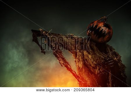 Portrait of a scary Jack-lantern with a pumpkin on his head. Halloween legend.