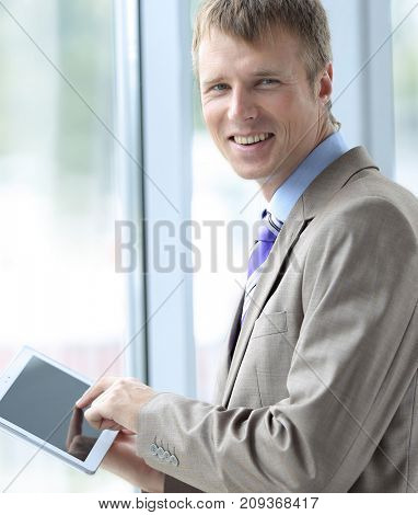 businessman wearing a shirt and tie using a digital tablet