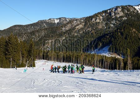 JASNA SLOVAKIA - JANUARY 23: The skiers school training is on in Jasna Low Tatras. It is the largest ski resort in Slovakia with 49 km of pistes on January 23 2017 in Jasna Slovakia