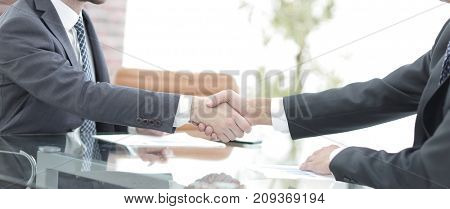 handshake of business partners on business negotiations