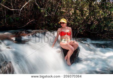 Mature Lady Forty Plus Enjoying a Beautiful Waterfall