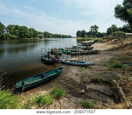 Boats On The Banks Of The River In The Czech Republic
