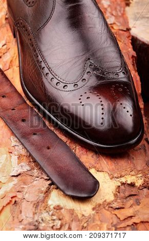 Brown Leather Chelsea Boots Polished With Leather Belt On Pine Board. Waxing Boots.copy Space.top Vi