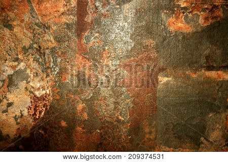 Background stone wall is old spotted brown. scratched