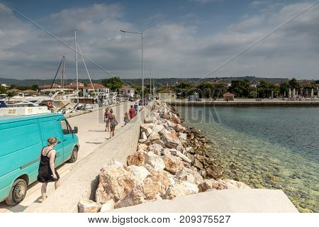 CHALKIDIKI, CENTRAL MACEDONIA, GREECE - AUGUST 25, 2014:  Seascape of port of Nikiti at Sithonia peninsula, Chalkidiki, Central Macedonia, Greece